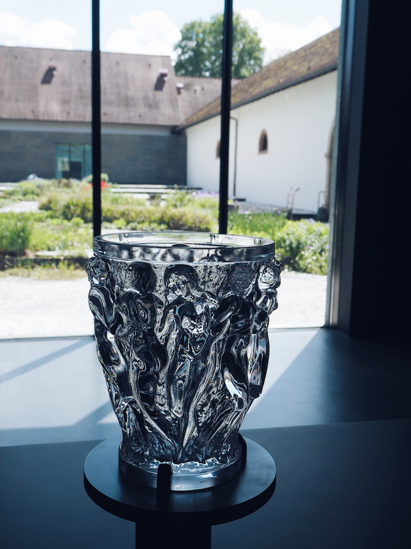 Lalique Bacchantes vase originally created bt Rene Lalique in 1927 with the Lalique Museum gardens in the background