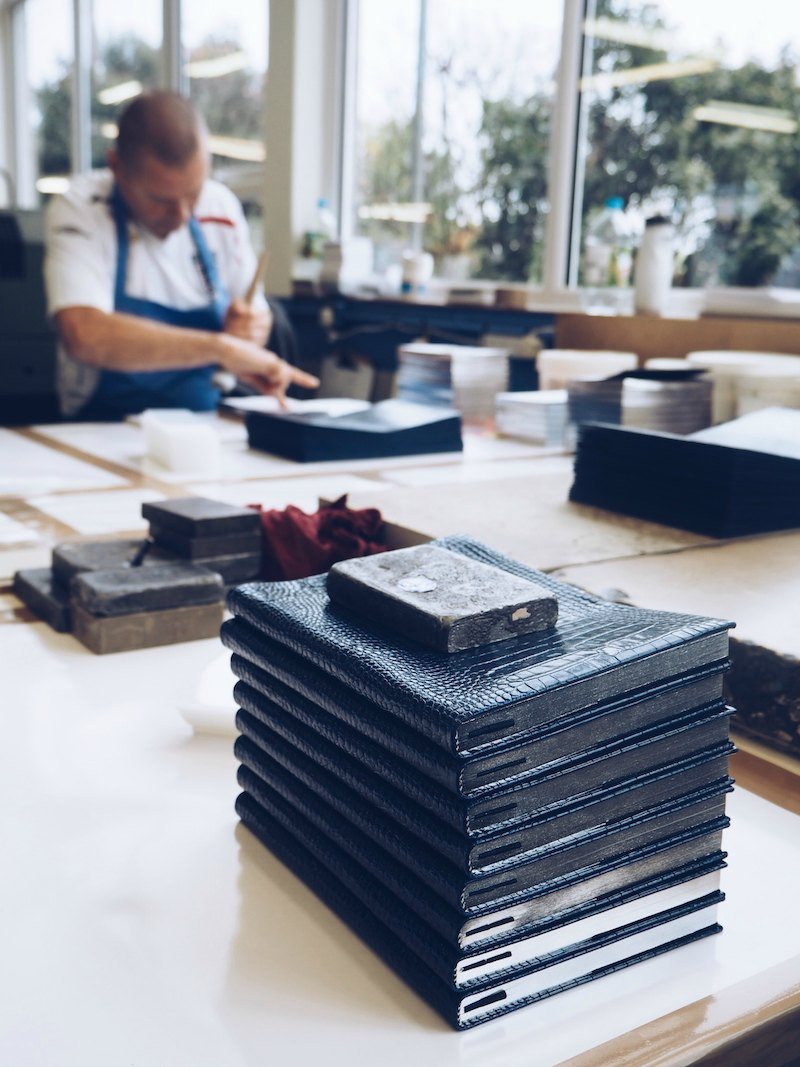 Smythson leather diary covers glued by hand at the bookbinding workshops