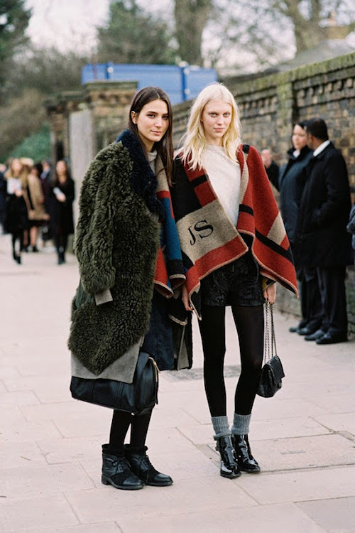 Models off duty in Burberry blanket poncho